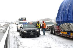 Montana Highway Patrol Trooper and others visiting while all traffic stops until the wreckage is moved off the Interstate. Traffic was down to one lane on the Yellowstone River bridge. (Jonathan McNiven photo)