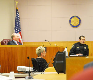Kevin Evans, undersheriff of the Yellowstone County Sheriff's department, testifies about officer training on Tuesday during the coroner's inquest into the shooting death of 28-year-old Loren Simpson. At left is Park County Coroner Al Jenkins, who presided over the inquest. (Judy Killen photo
