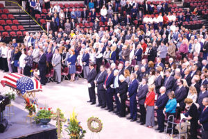 May 6 funeral for Sen. Conrad Burns at MetraPark drew a crowd of dignitaries and elected officials, including Gov. Steve Bullock, Montana's Congressional delegation, former Wyoming Sen. Alan Simpson and his wife of Cody, former U.S. Rep. Denny Rehberg and former Gov. Marc Racicot, all shown in the front row at right. Burn's family is in the front rows at left. (Judy Killen photo)