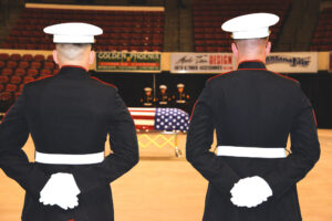 Flanked by members of Police Company Delta of the U.S. Marine Corps, Sen. Conrad Burns' casket, draped in a U.S. flag, awaits the family processional Friday morning at MetraPark. (Judy Killen photo)